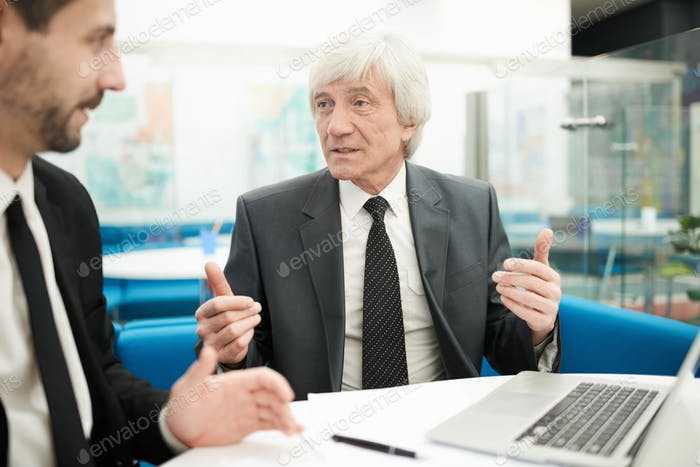 Senior Businessman in Meeting