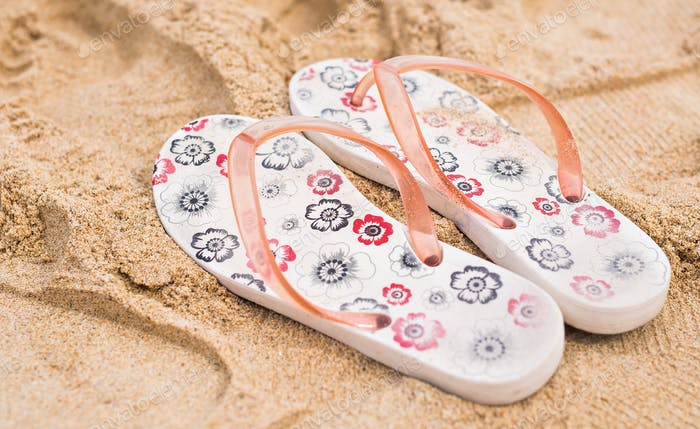 Tropical vacation concept-Flipflops on a sandy ocean beach