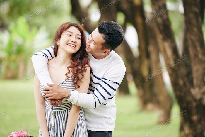Man hugging girlfriend