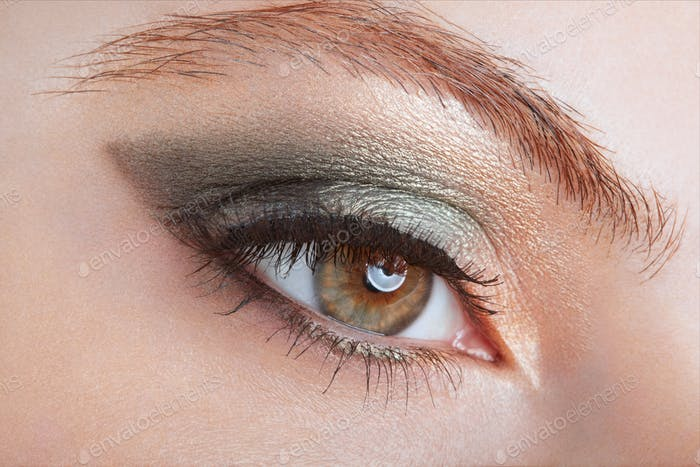 Woman with green eye smokey make up