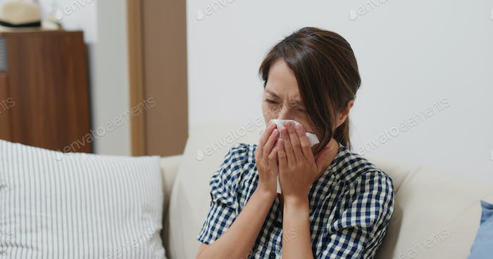 Woman suffer from influenza, sneeze at home