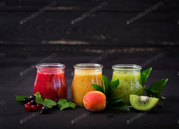 Fresh healthy smoothies from different berries on a dark background. Diet menu. Proper nutrition.