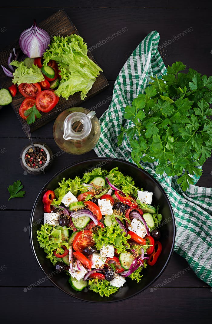 Healthy food. Greek salad with cucumber, tomato, sweet pepper, lettuce, red onion, feta cheese