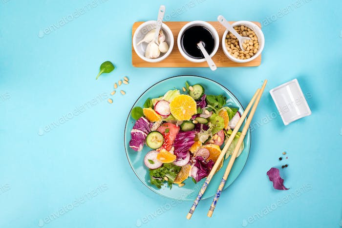 Organic vegetarian salad with vegetables and sauce.