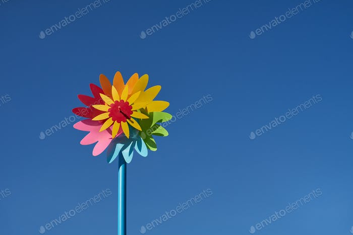 colorful pinwheel toy with clear blue sky