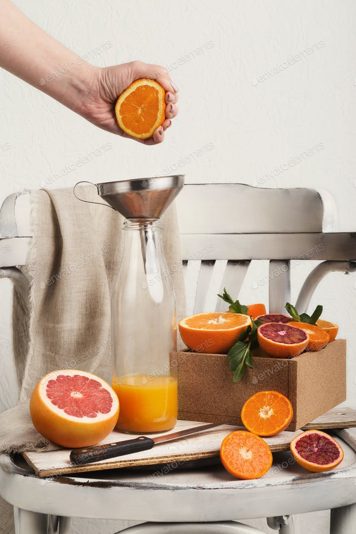 Preparing citrus fresh on white old chair