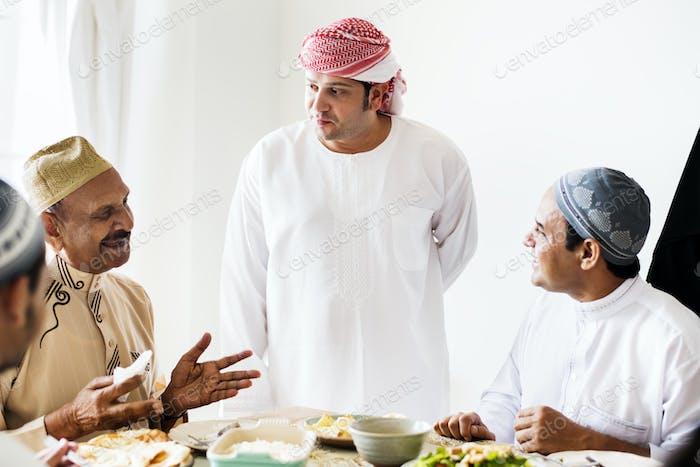 Muslim men having a meal