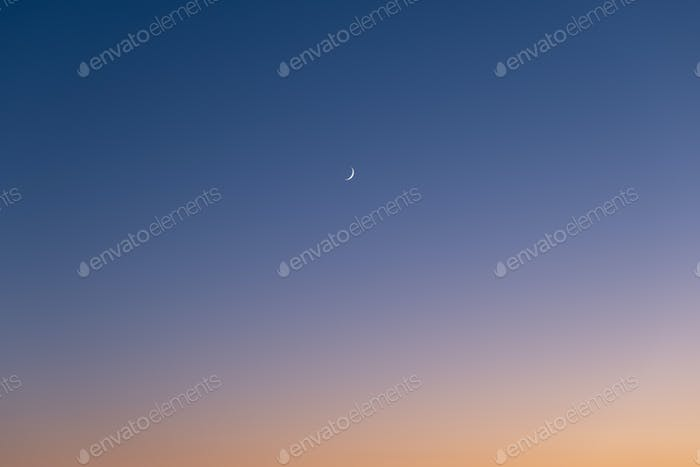 Sky color gradient as a background. Sky with moon during sunset.