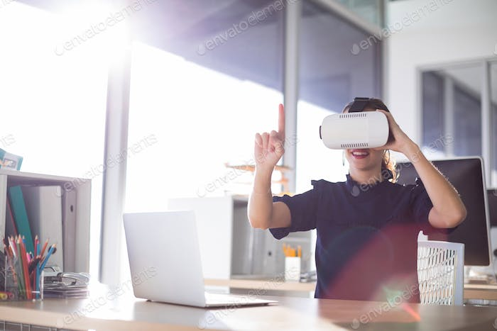Female executive using virtual reality headset