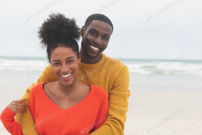 Couple standing at beach