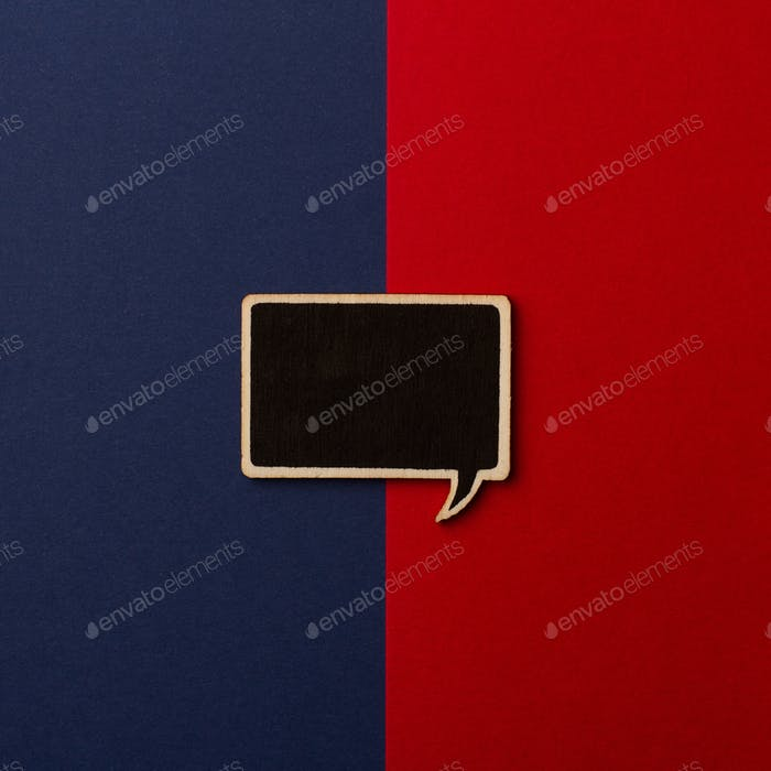 Square empty chalkboard wooden speech bubble on red and dark blu