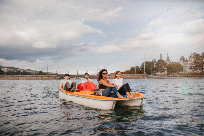 Group of people on pedal boat in lake