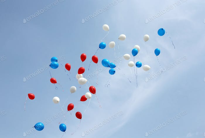colored balloons on sky