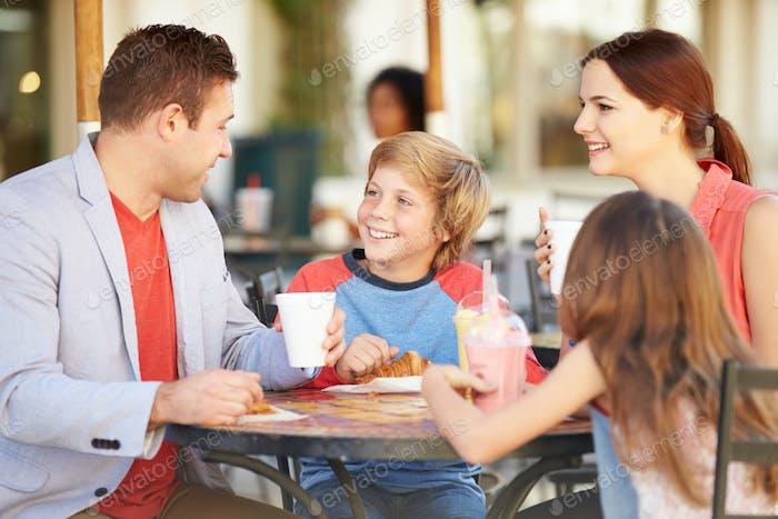Family Enjoying Snack In CafŽ