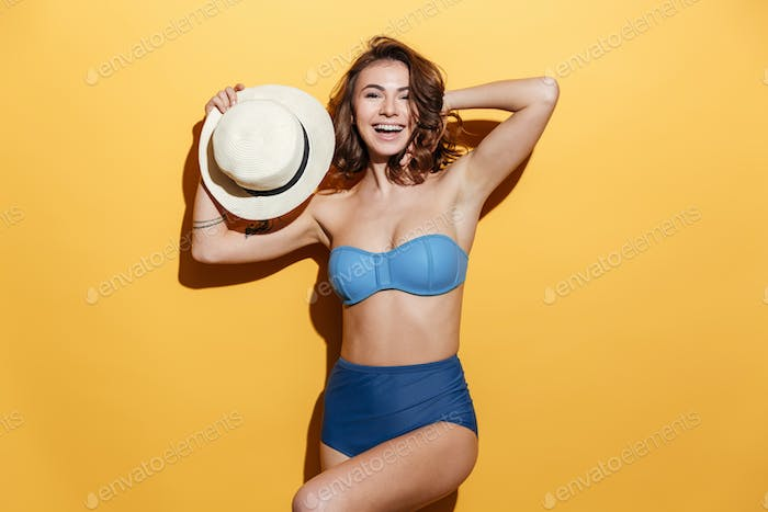 Happy young woman in swimwear