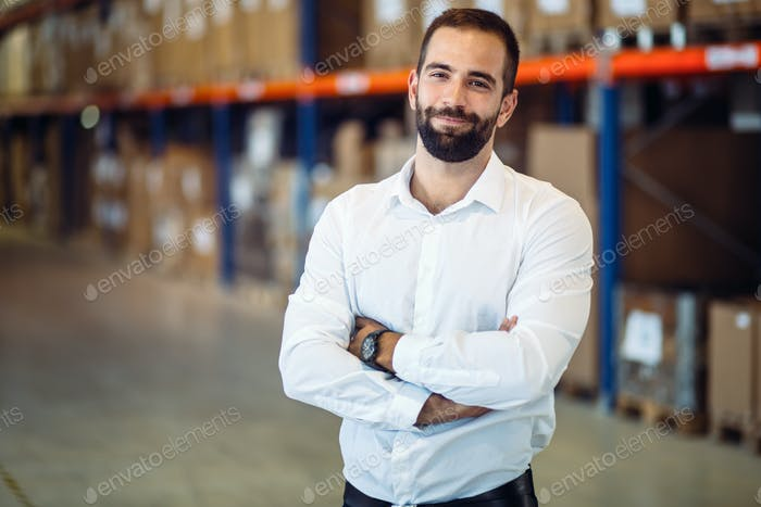 Logistics manager posing in warehouse