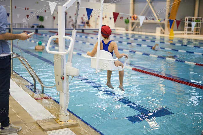 Child rehabilitation session in the swimming pool