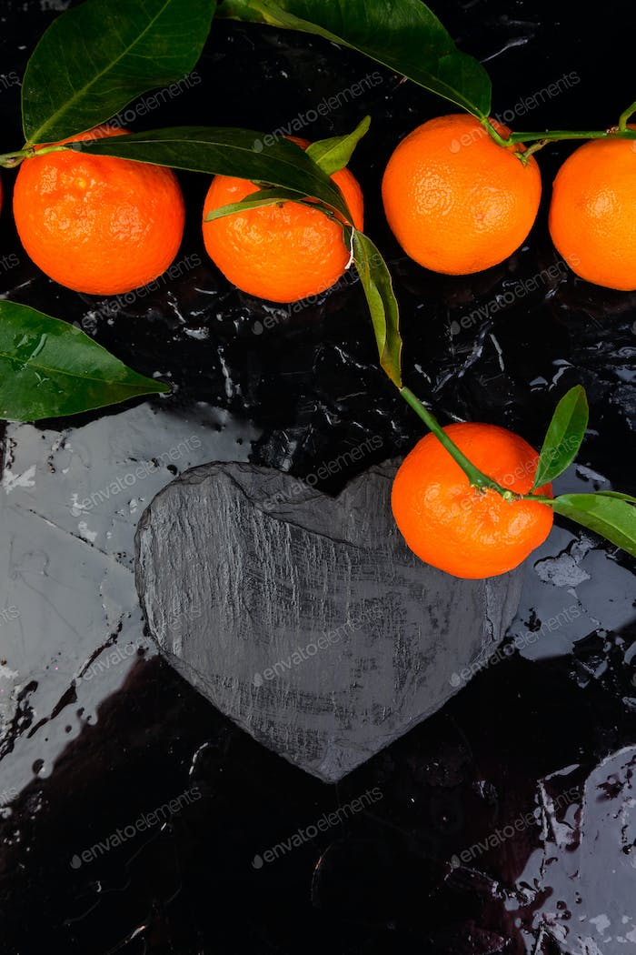 Thumbnail for Tangerine around with black slate heart shaped.