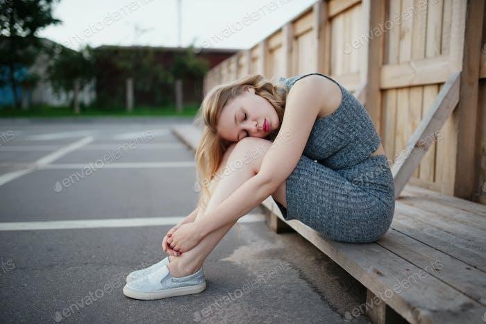 young beautiful blonde girl outdoors