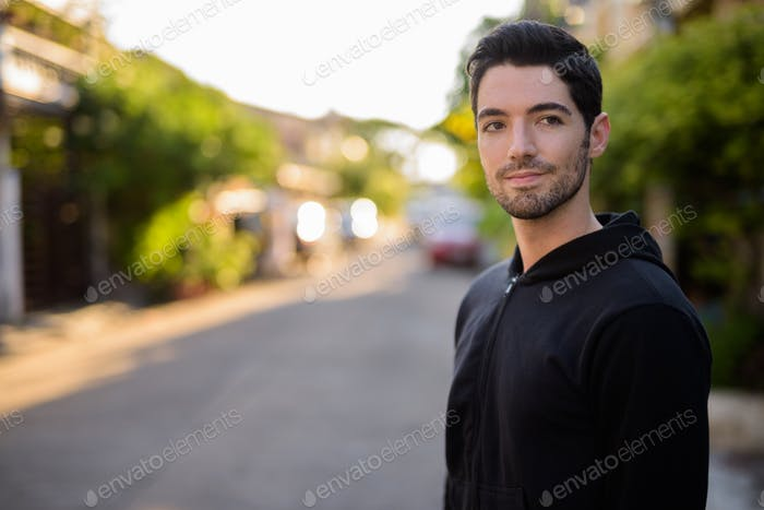 Young handsome man with stubble beard outdoors