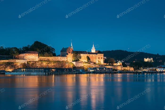 Oslo, Norway. Akershus Fortress In Summer Evening. Night View Of Famous And Popular Place