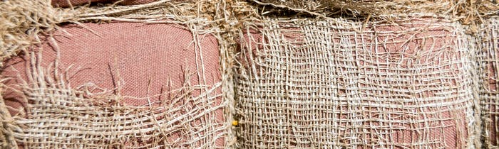 Banner of Tattered sackcloth background. Old burlap with hole.