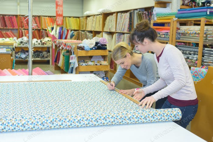measuring and cutting a fabric