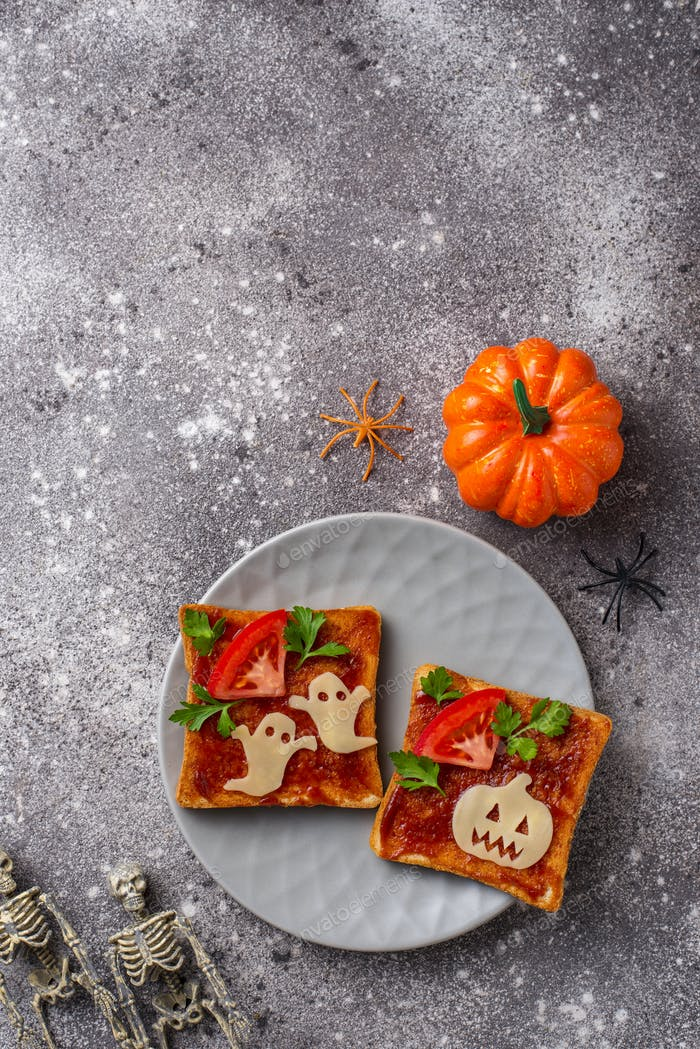 Halloween sandwiches toasts with ghost and pumpkin