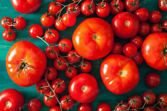 assorted tomatoes on wooden background
