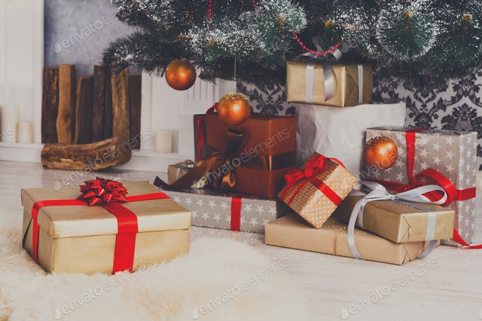 Christmas presents under fir tree, holiday concept