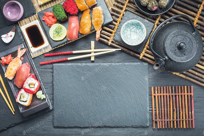 Asian style tableware with sushi set above