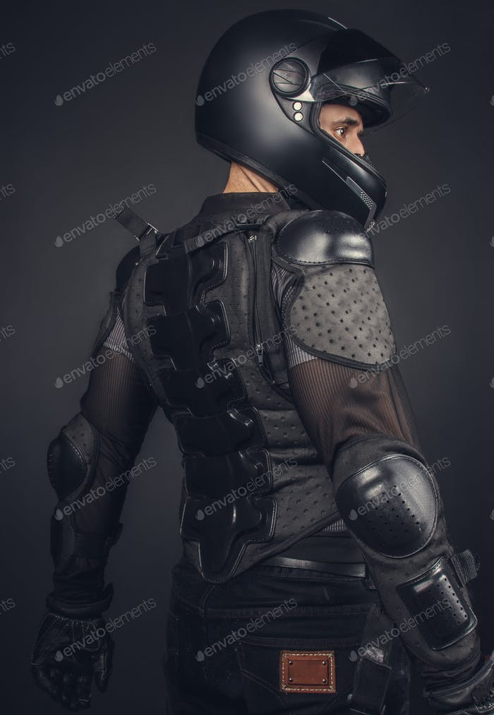 Biker in helmet and protection on his back.