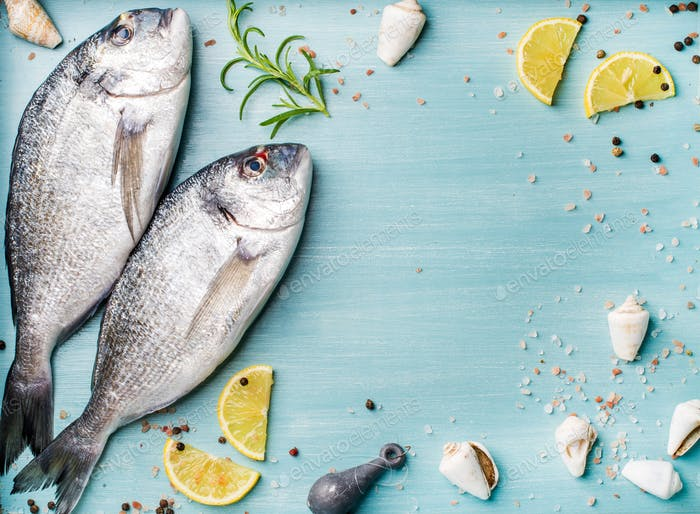 Fresh raw sea bream fish decorated with lemon