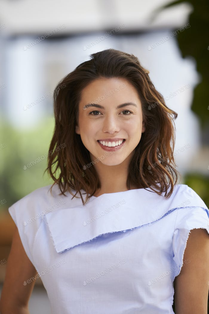 Portrait of smiling young mixed race businesswoman, vertical