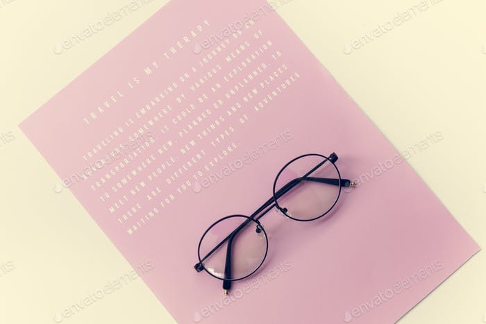 Eyeglasses with pink paper with message