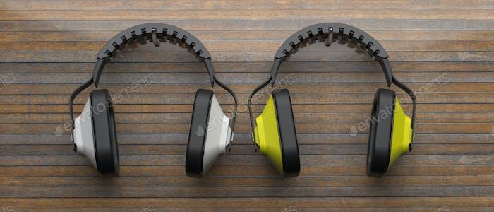Ear protection defenders on wood. 3d illustration