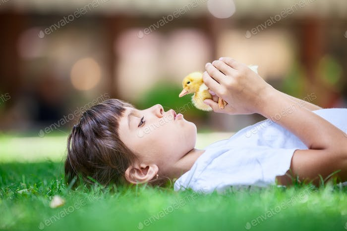 Girl with a spring duckling
