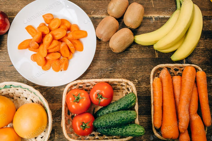 Fruits and vegetables on wooden table, top view