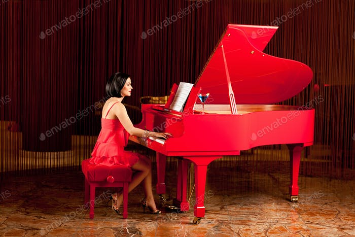 beautiful woman playing the piano