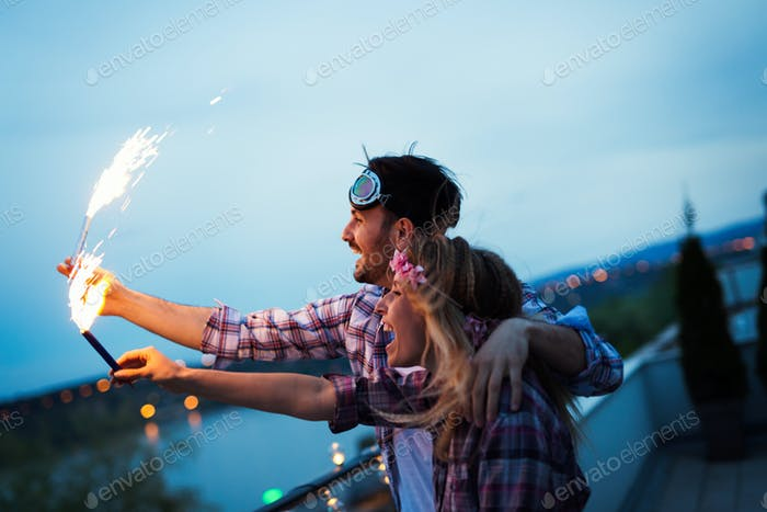 Happy couple having fun and partying on balcony