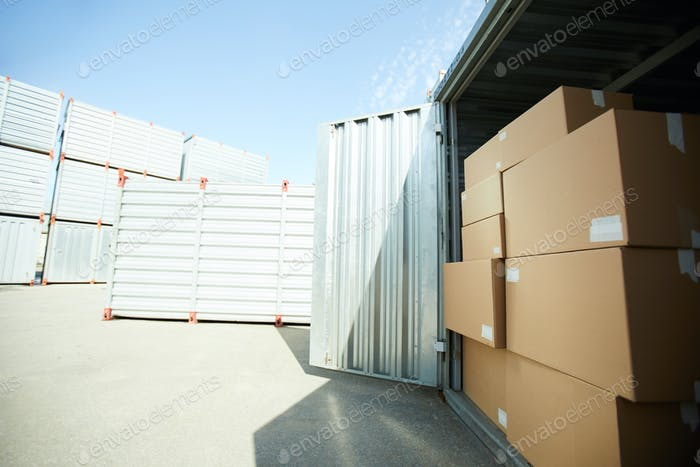 Open large container with stack of boxes