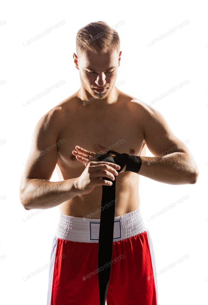 Fighter wrapping his hands with elastic band.