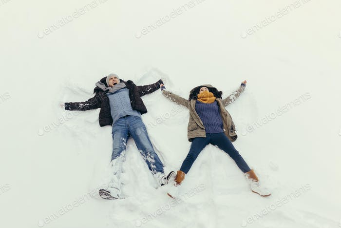 Cheerful young couple walking in a winter day