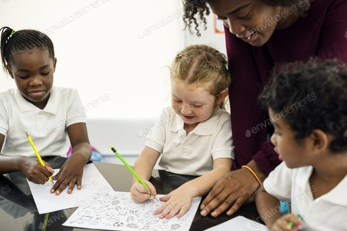 Group of diverse students drawing in art class