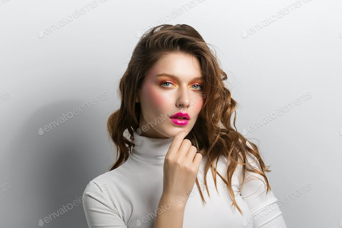 Coorful make up woman fashion beauty hairstyle close up face portrait
