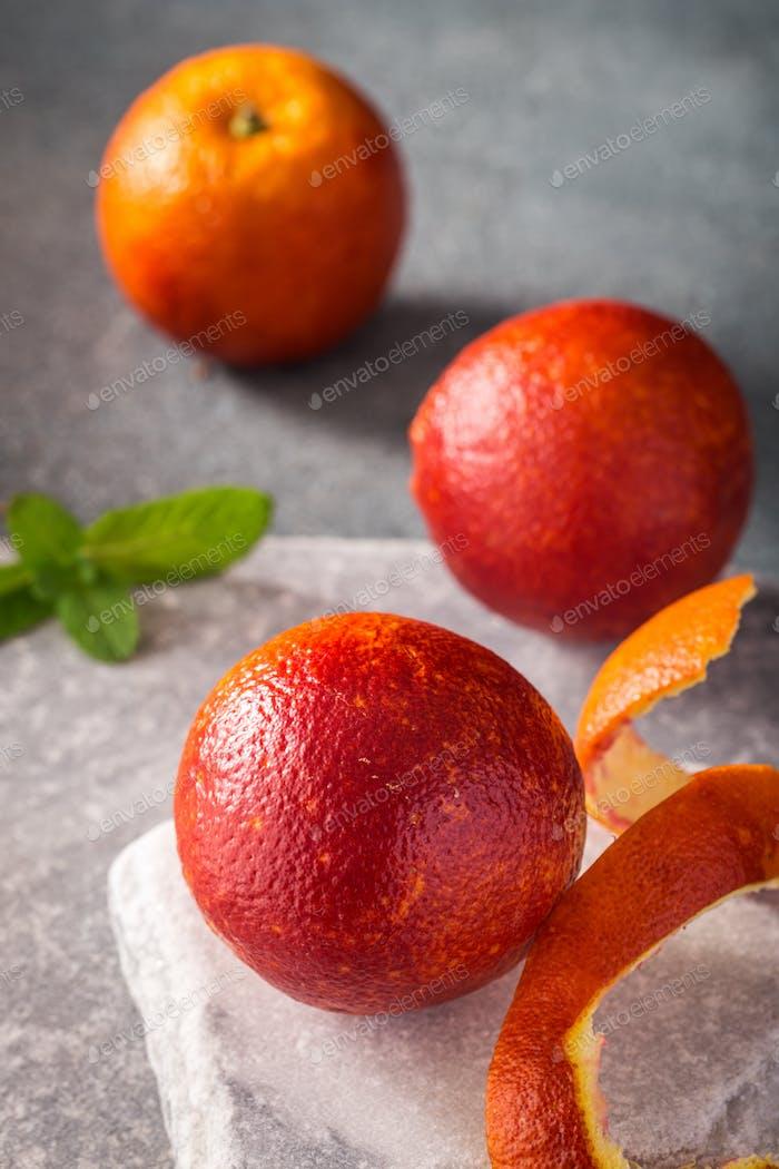 Blood oranges on stone