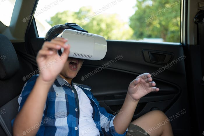 Teenage boy using virtual reality headset