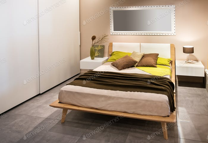 Modern bedroom with wooden Scandinavian style bed