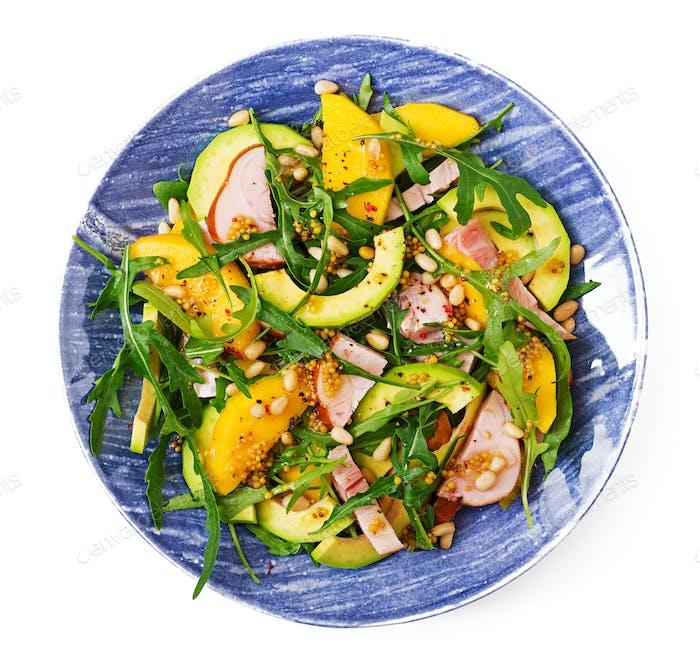 Holiday salad with smoked chicken, mango, avocado and arugula. Flat lay. Top view
