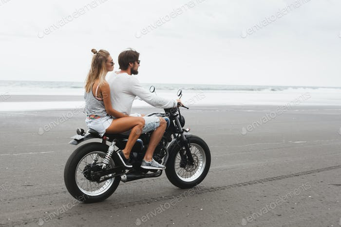 Young beautiful couple riding motorcycle